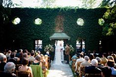 A Goodstone outdoor wedding is held in front of the facade of the old mansion.