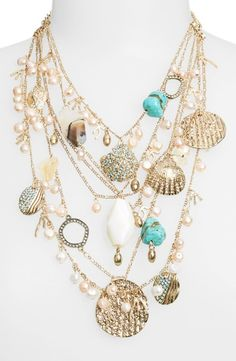 """Sea Life Multistrand Statement Necklace""""A nautical bounty decorates this gorgeous statement necklace with an eclectic mix of milky pearls, dyed quartz stones and crystal-laden seashells. Buy here. """""""
