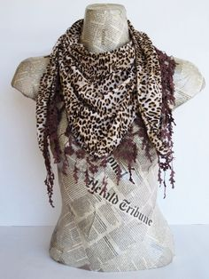 tis cool.  scarf or shawl with lace.  brown leopard.