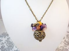 Hey, I found this really awesome Etsy listing at https://www.etsy.com/listing/130529657/purple-and-orange-antique-brass-necklace