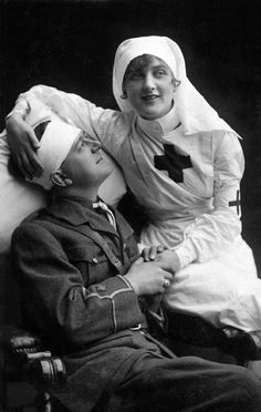 British WWI photo postcard of an injured soldier and a nurse