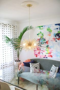 Our signature gold urchin chandelier in this gorgeous, colorful dining space from https://www.cuckoo4design.com.