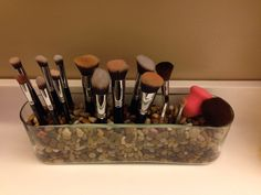Cute way to store make-up brushes.