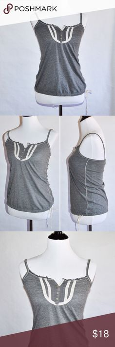 """Grey Sleeveless AEO Top Grey Sleeveless AEO Top 60% Cotton / 40% Polyester   Cute and sweet grey top with front detail. Good condition. Drawstring tie bottom. Straps are adjustable.  Measurements Small-Chest:14"""" across / 28"""" around, Length:23""""  🔆Bundle 2 items = 10% OFF 🔆Bundle 3 or more = MAKE OFFER ❌ No Trades American Eagle Outfitters Tops Tank Tops"""