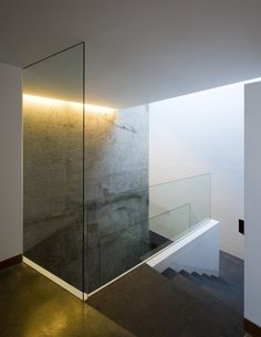 I like how this glass surround for the staircase allows light to move through much more effectively than a solid wall.