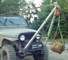 Crane by Caper -- Homemade crane constructed by welding adaptors to the ends of a repurposed clothesline brace to facilitate mounting to a Jeep. http://www.homemadetools.net/homemade-crane-8