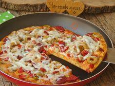 En kolay en lezzetli pizza tariflerinden... Tavada olması da bir başka güzel... Üstelik hamur açma, mayalama derdi de yok... Harcı hazırla, koy tavaya :) Hepsi bu kadar...