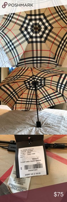 Burberry Giant Check Folding Umbrella Classic, chic Burberry umbrella. Compact version that will fit easily in any purse for great portability. Burberry Accessories Umbrellas