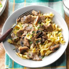 Beef Burgundy Over Noodles Recipe -I got this delightful recipe from my sister-in-law many years ago and have used it ever since. Whenever I serve it to guests, they always request the recipe. The tender beef, mushrooms and flavorful sauce are delicious over noodles. —Margaret Welder, Madrid, Iowa