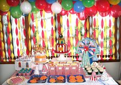 Twist crepe paper streamers and top with balloons to create a fun party table backdrop!