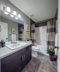 """We have a four piece bath surround as well and I like how they continued the tile all the way to the ceiling. Instead of replacing a perfectly good tub and surround, it's a nice """"upgrade""""."""