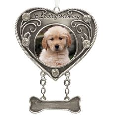 This memorial ornament is a  beautiful way to remember your beloved pet at the holidays or every day.  Perfect to give as a sympathy gift when someone loses their faithful friend.  Hang the memory and photo of your beloved pet on your holiday tree each year with this pewter heart-shaped memorial ornament.  Written keepsake verse is included and says: