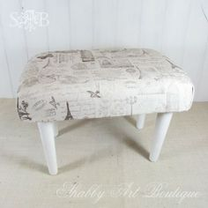 The fabric for this foot stool was a drop cloth stamped in permanet ink...Nice! (Love this blog that I discovered through this pin!)