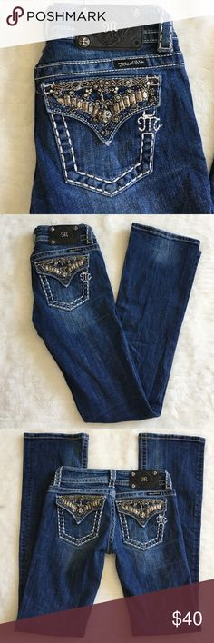 """Miss Me Bootcut Jeans Size 25x32"""" Preowned Miss Me Bootcut Jeans Size 25x32"""". Rise is 7"""" inches. Jeans have signs of loving wear. Missing one stud from back leather tag as well as some rhinestones from pockets. Please look at pictures for better reference. Cuffs have wear in back. Thank you for looking and happy shopping!! Miss Me Jeans Boot Cut"""