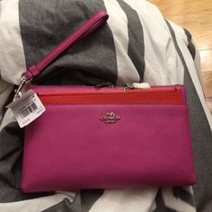 Coach wristlet Pink and orange with popout! PRICE IS Most likely firm but plz make me a reasonable offer NO TRADES Coach Bags Clutches & Wristlets