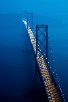 Blue San Francisco-Oakland Bay Bridge ...Double decker toll bridge that connects San Francisco Bay to cities, including San Francisco and Oakland. This bridge opened 6 months before the Golden Gate Bridge.
