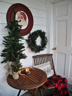 An antique Santa watches over the cozy sunroom.