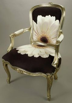 Beautiful chair in black fabric with white flower, lovely idea.
