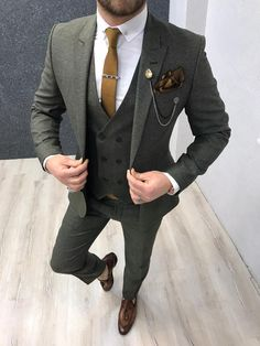 Collection: Spring – Summer 2020 Product: Slim-Fit Wool Suit Color Code: Olive Green Size: Suit Material: wool, polyester Machine Washable: No Fitting: Slim-fit Package Include: Jacket, Vest, Pants Gifts: Chain, Flower and Neck Tie Dry Clean Only Green Suit Men, Olive Green Suit, Mens Fashion Suits, Mens Suits, Dress Suits For Men, Classy Suits, Designer Suits For Men, Slim Fit Suits, Formal Suits