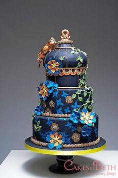 Birdcage, bird and tropical exotic flower three tier cake.