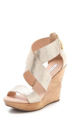 diane von furstenberg wedges. can't go wrong with nude. gold sheen/metallic finish on straps.
