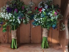 Spring bridesmaids bouquets with hessian binding