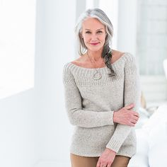 Knit from the top down, this boatneck pullover has an open, circular yoke with raised stitch detail. Flirty and refined,...