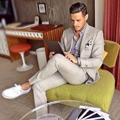 How To Style Sneakers with a Suit...gray suit and white sneakers. Laid back business casual men's style.
