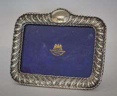 LOT 1: A rectangular swirl decorated picture frame with velvet back. Birmingham. By WG Ltd. Est. £50 - £80. Coming up in our #Silver #Jewellery #Toys and #Railwayana #Auction on Thursday 25th May. To include #Watches #Collectables #Pictures #China & #Antique #Furniture #May25 #whittonsauctions #Honiton #pin