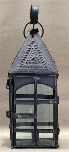 John is a tinker or a tinsmith crafting lanterns and other items made of tin, as well as making repairs to pots, pans, and other utensils. Primitive Lighting, Antique Lighting, Grey Wallpaper, Geometric Wallpaper, Lantern Candle Holders, Candle Box, Candle Lamp, Old Lanterns, Antique Lanterns