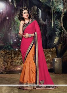 Get going with this majestic and wonderful piece and make your dream attire look richer to your persona. Look ethnic in this affluent hot pink and orange georgette and jacquard silk classic designer s...