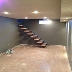 Finishing out the drywall by the floating stair base