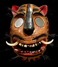 Mexican Jaguar Mask    Real boar's teeth, mirrors and boar bristles - in the USA it is hard to imagine the current use of these dance masks but the dances are real & meaningful - for more on Mexico visit www.mainlymexican.com #Mexico #Mexican #mask