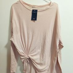 NWT Distressed Pink Long Sleeve Soft oversized long sleeve with distressed details. Cheaper with free ship through PP and merc! ❌NO TRADES❌ Brandy Melville Tops Tees - Long Sleeve