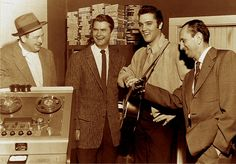 Rock and roll singer Elvis Presley poses with record producer Sam Phillips, Leo Soroka and Robert Johnson at Sun Recording Studios in Memphis, Tennessee on December Get premium, high resolution news photos at Getty Images Robert Johnson, Power Metal, Rock And Roll, Miss Tennessee, Memphis Tennessee, Big Boss Man, Scotty Moore, Sam Phillips, Surf