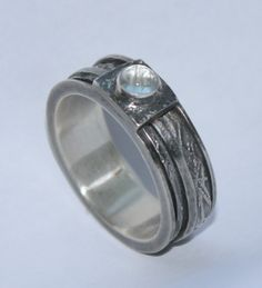 Oxidised and textured silver ring with moonstone cabochon