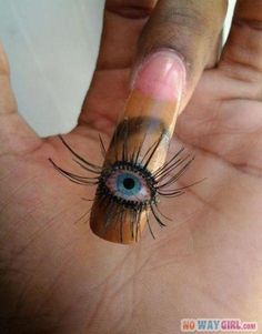 Ghetto Eye Nail Design. Too bizarre for me, but it's eye-catching. Get it? Bad puns make the world go round.