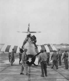 16 June 1944: A dazed 1LT Jacob C. Blazicek, 367FS/358FG is lifted from the cockpit of his P-47D (42-76436, coded CP-D) at Cardonville airstrip.