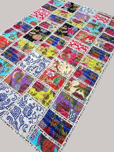 here i present the masterpiece of Indian quilting. this magnificent quilt is prepared with 50 block of most popular kantha pattern.    details:    size