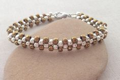 Easy step by step instructions to make a 2 bead wide chain bracelet using seed beads and brick stitch.