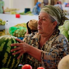 Carefully checking the melons in Uzbekistan.