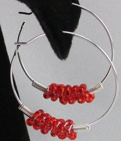 Each 30mm silver plated hoop ear wire has a wire bead that is created by wire coiled seed beads.