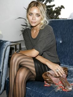 leather mini, patterned stockings, simple grey cotton tee with rolled sleeves. I'll take the skin, hair and make-up, too.
