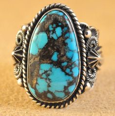 Handmade ring, with natural rare gem grade Cloud Mountain Turquoise, by Navajo artist Donovan Cadman.