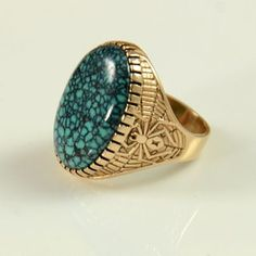 14kt Gold and Turquoise Ring by Andy Lee Kirk. Andy Lee Kirk was a Master contemporary Native American artist of Isleta and Navajo heritage, who died tragically at the height of his career at the age of 54. He created beautiful gold and silver jewelry using the finest materials from 1970 to 2001. Born in 1947, he originally earned a degree in biology continuing on to work for the Fish and Wildlife and Forest Services.