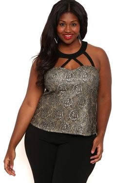 You're sure to shine in this pretty tank. This plus size tank top has glitter lace, a caged neckline and a zipper at the back. We love this top with skinny black pants and chunky heel booties.