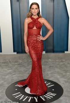 Glittering: Kate Beckinsale gleamed like an Oscar statuette as she arrived at the Vanity F...