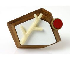 katy hackney  'White Brooch with Twig' in formica, wood, bamboo, cellulose acetate, silver, steel