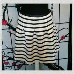 GAP blue and white striped skirt Soft knit, all over print Fitted at waist, pleats gives a full silhouette  Hits above the knee  Great Condition GAP Skirts Mini
