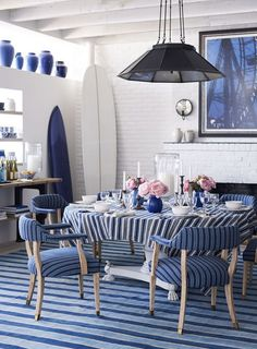 Coastal dining space with layers of stripes to create a unique look